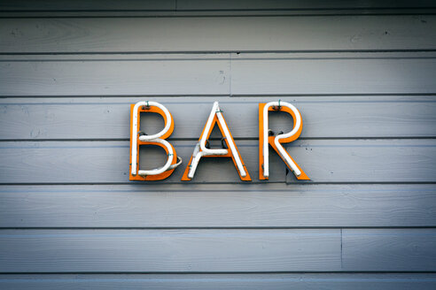 Bar yellow sign on wooden wall. - INGF11829