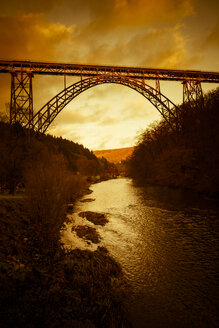 Germany, Muengsten Bridge between Solingen and Remscheid with Wupper in the foreground at twilight - SKAF00107