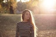 Portrait of young woman in a park at sunset - LOTF00004