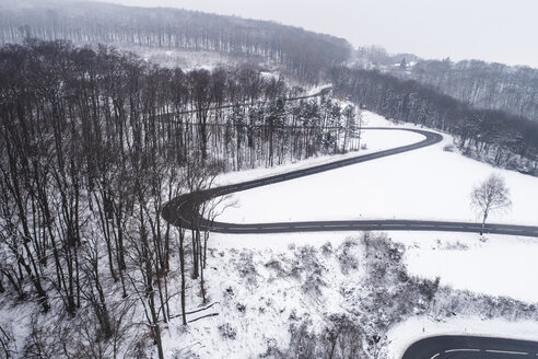 Austria, Wienerwald, drone shot of a snowy mountain road - HMEF00172