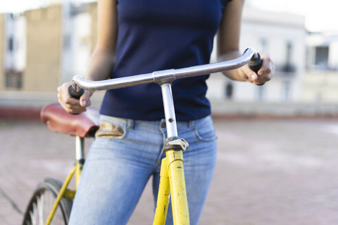Close-up of young woman with bicycle in the city - ERRF00430