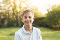 Portrait of young blond boy (12-13) looking at camera - ASTF00207