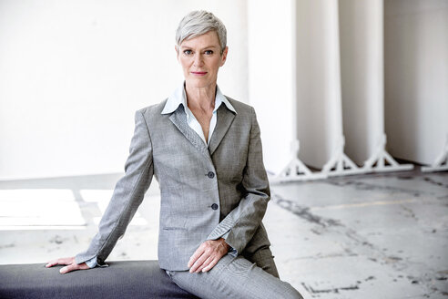 Portrait of mature businesswoman  wearing grey pantsuit - VWF00029