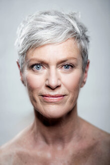 Portrait of mature woman with short grey hair and blue eyes - VWF00047