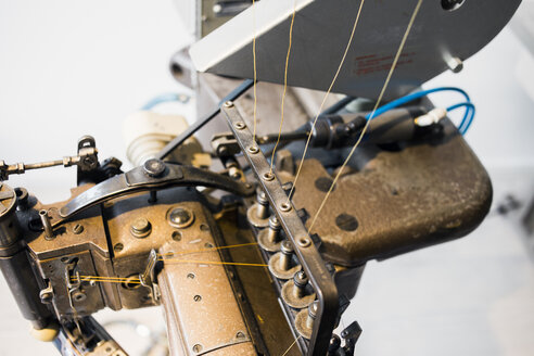 Close-up of sewing machine in jeans factory - ASTF00983