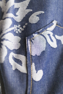 Close-up of floral pattern on jeans - ASTF01007