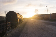 Railroad tracks by road against sky - ASTF01076