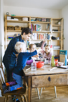 Father baking breads with children at home - ASTF01259