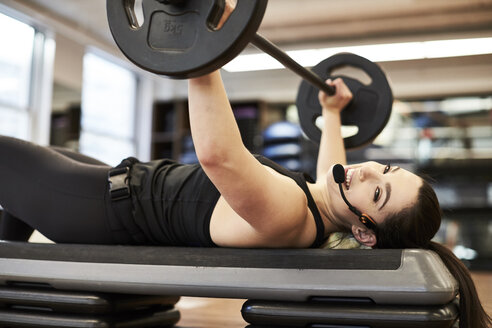 Fitness instructor doing bench press - AURF08115