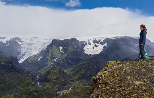 Hiker looking down toThorsmorkvalley,Sudurland, Iceland - AURF08136