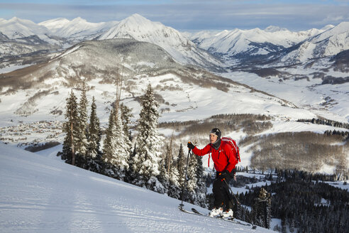 Woman skiing up hill, Crested Butte, Colorado, USA - AURF08160