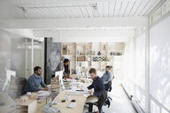 Architects working in open plan office - HEROF03789
