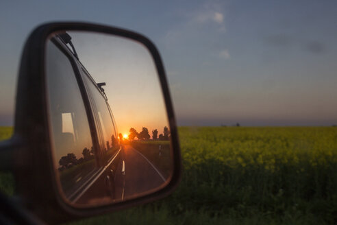 Germany, Ruegen, Cape Arkona, sunset mirrored in wing mirror - MAMF00273