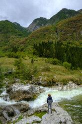 Slovenia, Soca Valley, hiker at Lepenjica river, Triglav National Park - LBF02318