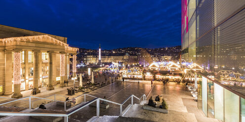 Germany, Baden-Württemberg, Stuttgart, Christmas market on castle square at night - WD04998