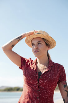 Portrait of tattooed young woman on the beach - LOTF00019