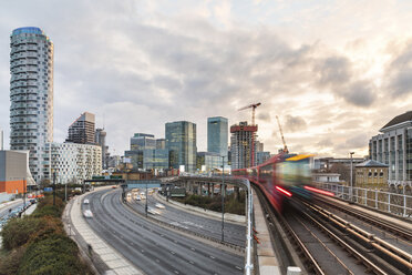 United Kingdom, England, London, inancial district with busy road and blurred metro train on foreground - WPEF01261