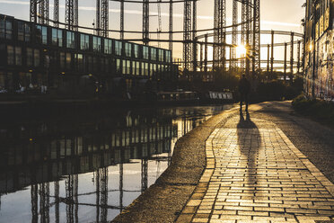 United Kingdom, England, London, man standing at Regent's canal against the evening sun - WPEF01270