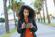 Young woman using digital tablet outdoors - KIJF02164