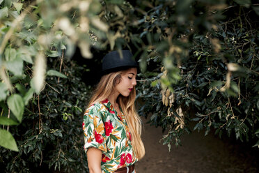 Blonde young woman surrounded by leaves and nature. Barcelona, Catalonia, Spain. - LOTF00025
