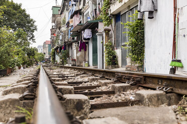 Hanoi, Vietnam, view of a railway crossing the city and passing very close to houses - WPEF01278