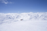 France, French Alps, Les Menuires, Trois Vallees, skiers enjoying view at distance - SKAF00126
