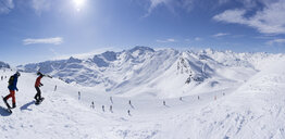 France, French Alps, Les Menuires, Trois Vallees, Panoramiv view with snowboarders - SKAF00129