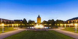 Germany, Mannheim, Friedrichsplatz with fountain and water tower in the background at blue hour - WDF05013