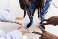 Friends touching with fingers of their hands, making a star shape - GIOF05373