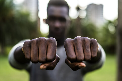 Young man showing his fists - GIOF05424