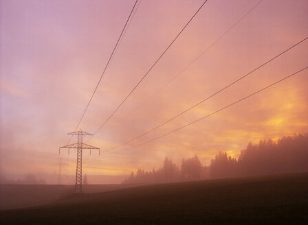 Power pylon in hazy rural landscape - WWF04760