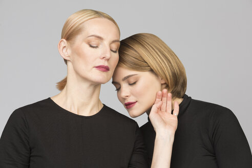 Studio portrait of mother and adult daughter - VGF00153