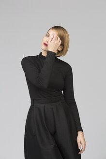 Studio portrait of elegant young woman - VGF00165