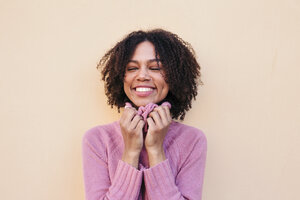 Portrait of happy young woman wearing pink pullover - LOTF00039