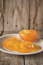 Sliced candied orange on plate - EPF00524