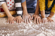 Mother and children with flour on their hands, partial view - JRFF02342