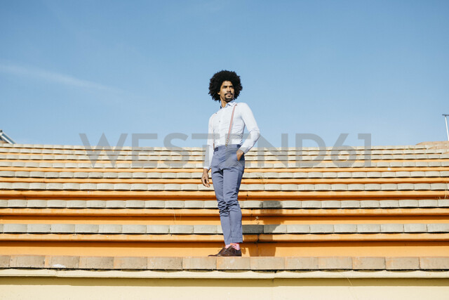 Stylish man standing on stairs - JRFF02421 - Josep Rovirosa/Westend61