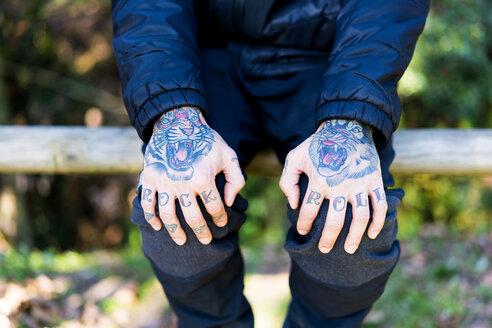 spain, girona, girona, detail of a tattooed hands on a man - XCF00187