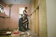 Construction workers framing inside of house - HOXF04256
