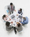 High angle view businessman leading meeting at round table - HOXF04310