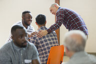 Men talking, comforting in group therapy - CAIF22576