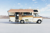 Vintage Dodge Sportsman RV with striped canopy parked on Salt Flats - MINF09993