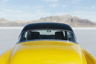 Restored yellow 1952 Vintage Chevy Bel Air car parked on Salt Flats - MINF09999