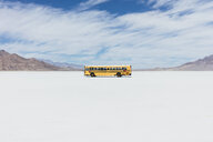 Yellow school bus driving on Salt Flats - MINF10014
