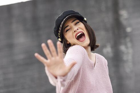 Portrait of posing young woman wearing cap - JSMF00722