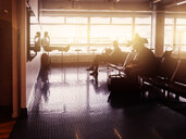Silhouette of businessmen waiting at airport - ASTF01290