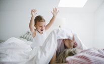 Happy toddler son playing with mother in bed at home - HAPF02818