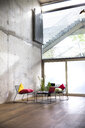 Sitting area in a loft at concrete wall - FKF03154