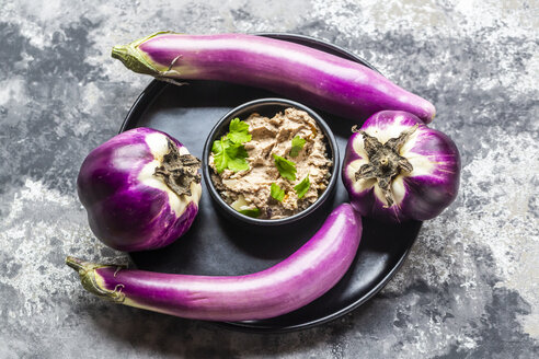 Bowl of homemade aubergine cream with walnuts, parmesan and parsley served - SARF04047