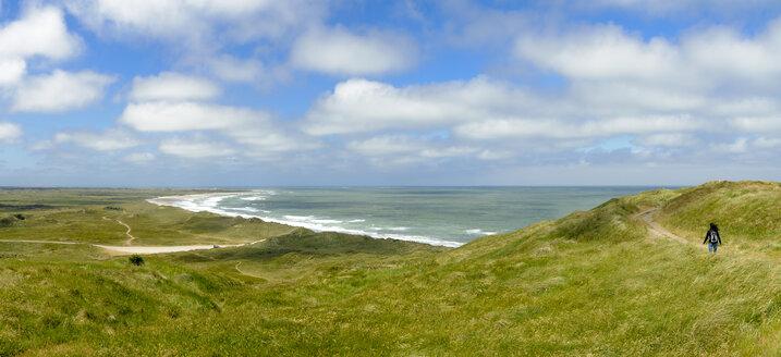Denmark, Jutland, woman walking in dune landscape - UMF00873